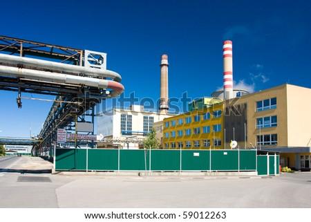 Photo of power plant with sunny sky - stock photo
