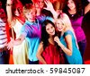 Photo of pretty girls singing in mic at party with their friends behind - stock photo