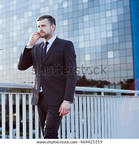 Photo of professional businessman in the city during business call
