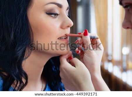photo of Professional makeup artist doing makeup