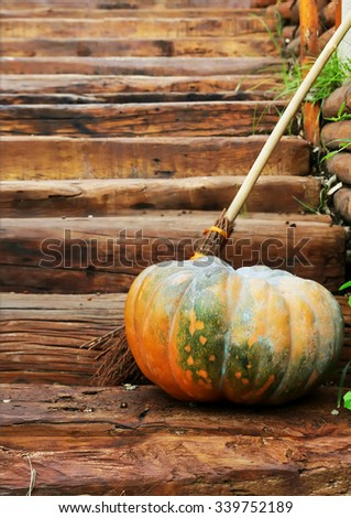 Photo of pumpkin on wooden stairs - stock photo