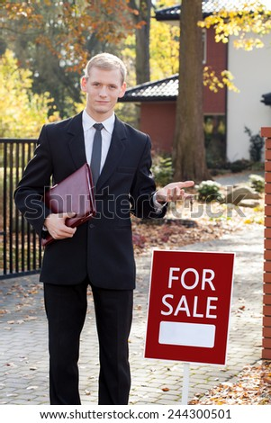Photo of real estate agent waiting for clients