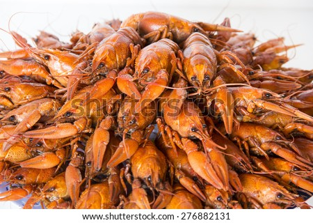 Photo of red boiled crawfishes on the dish