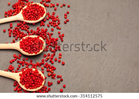 Photo of red peppercorns over stone table - stock photo