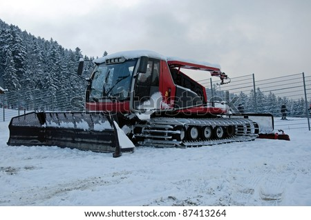 Photo of red snowgroomer in winter