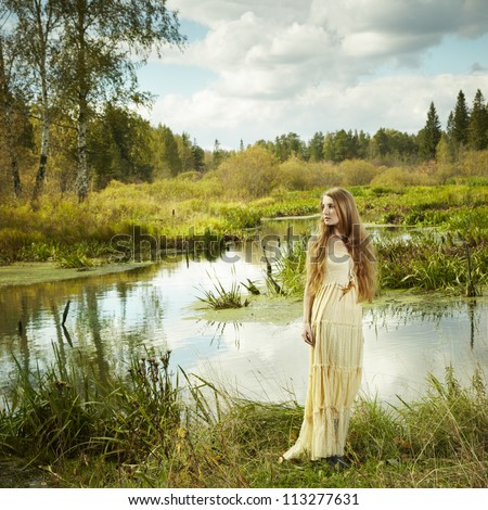 Photo of romantic woman in fairy forest. Beauty autumn - stock photo