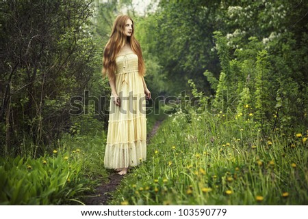 Photo of romantic woman in fairy forest. Beauty summertime - stock photo