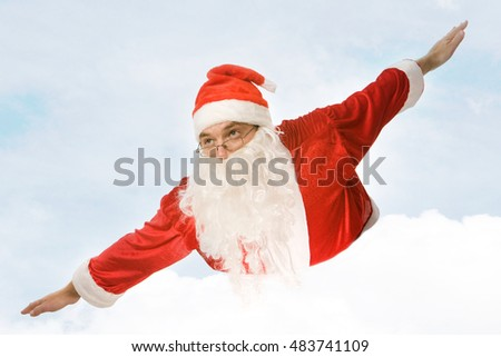 Photo of santa claus flying on the background of sky
