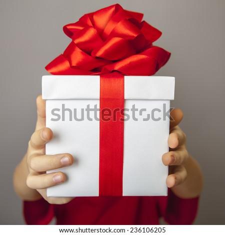 Photo of Santa Claus gives a gift - stock photo