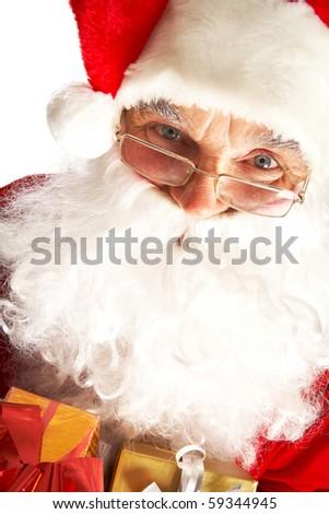 Photo of Santa Claus in eyeglasses looking at camera - stock photo