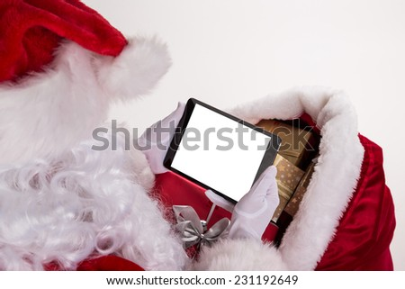 Photo of Santa Claus with tablet on white background. - stock photo