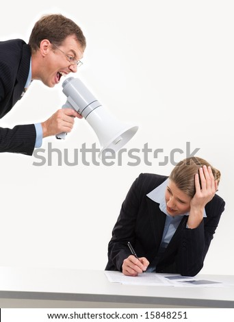Photo of scared businesswoman closing her ears by hands while boss screaming into loudspeaker at workplace - stock photo