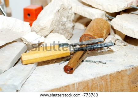Photo of Sculptor Tools and Pieces of Marble - stock photo