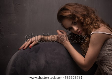 Photo of sensual  brunette woman in room