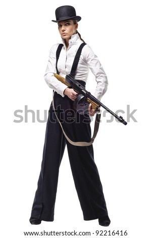 Photo of sexy gangster girl holding machine gun. Isolated over white