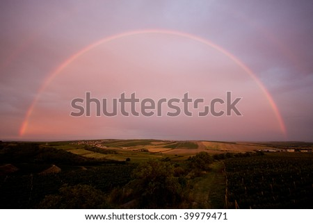 Photo of sky with beautiful sunset and rainbow