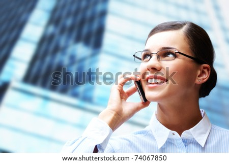 Photo of smart businesswoman calling somebody by mobile telephone - stock photo