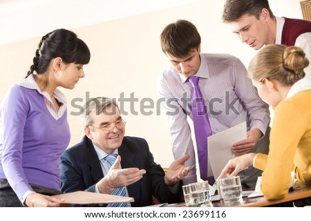 Photo of smart colleagues interacting at meeting in office - stock photo