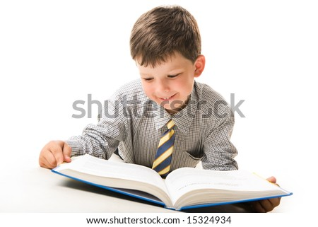 Photo of smart pupil lying and reading textbook over white background