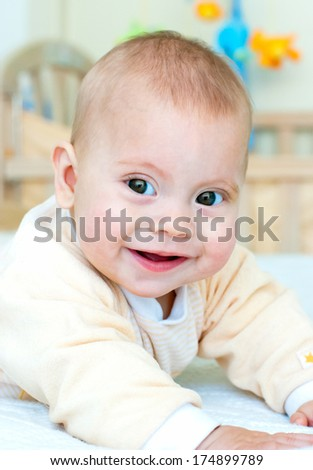 Photo of smiling cute boy lying on the bed
