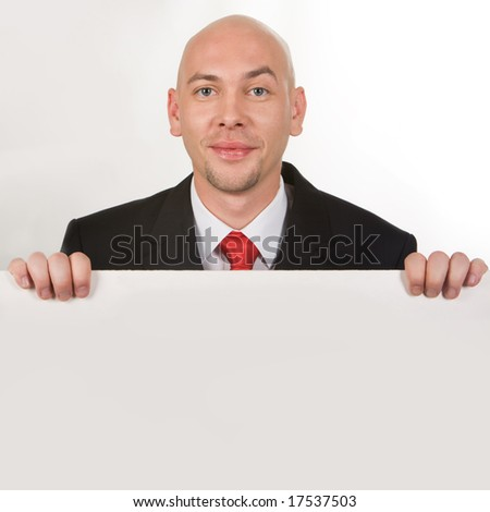 Photo of smiling male behind partition looking at camera - stock photo