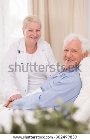 Photo of smiling male patient of geriatric ward - stock photo