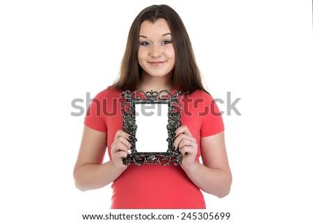 Photo of smiling teenage girl with photo frame on white background - stock photo