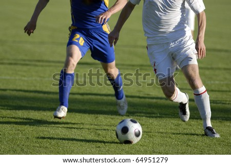 Photo of soccer players with ball in action - stock photo