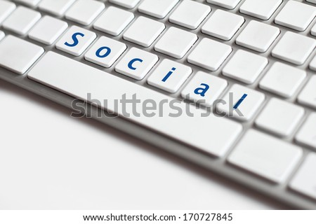 Photo of social button on the white keyboard.