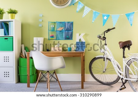 Photo of spacious cosy furnished new design teenager room - stock photo