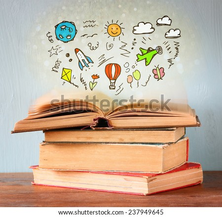 photo of stack of old books. top one is open with set of infographics. imagination and education concept. - stock photo