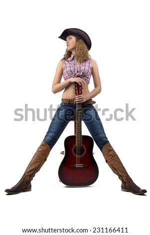 Photo of standing cowgirl with the guitar on white background - stock photo