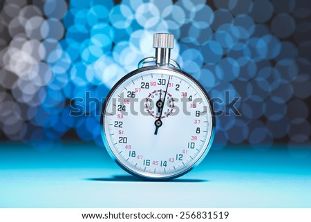 Photo Of Stopwatch On Blue Bokeh Background - stock photo