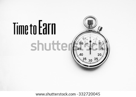Photo of stopwatch with quote: Time to Earn - stock photo