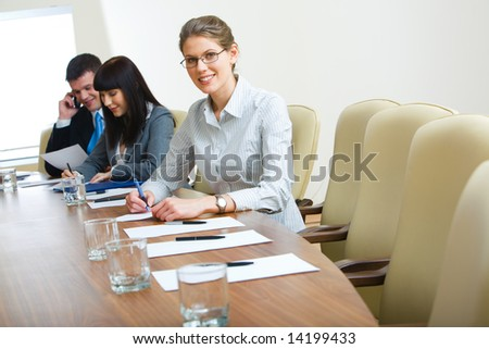 Photo of student sitting at the table at business conference - stock photo