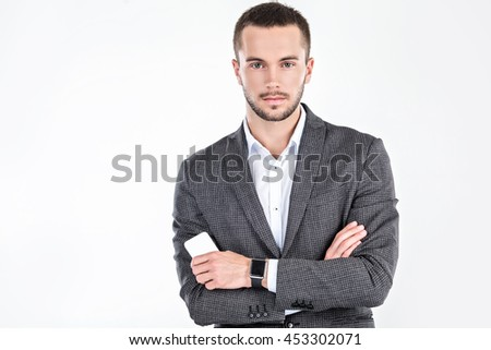 Photo of stylish handsome young man isolated on white background. Man with smart watch and mobile phone - stock photo