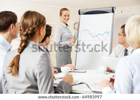 Photo of successful businesswoman presenting new project to partners