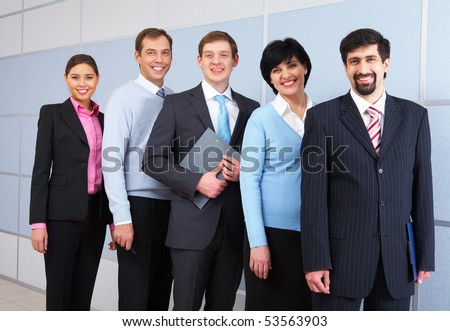 Photo of successful employees looking at camera - stock photo