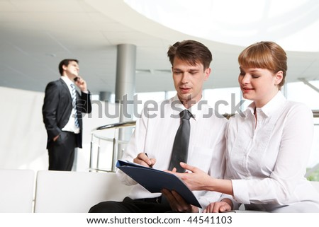 Photo of successful partners planning work with calling man at background - stock photo