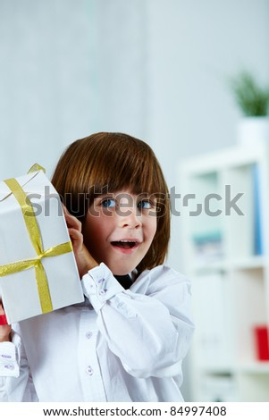 Photo of surprised boy with giftbox - stock photo
