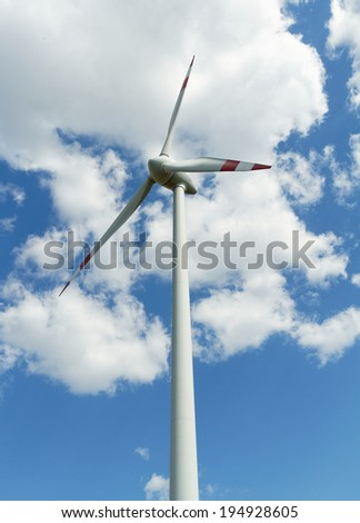 Photo of tall windmill on the plains