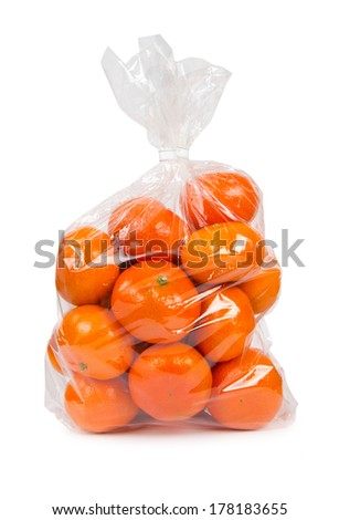 Photo of tangerines in a plastic bag isolated on white - stock photo
