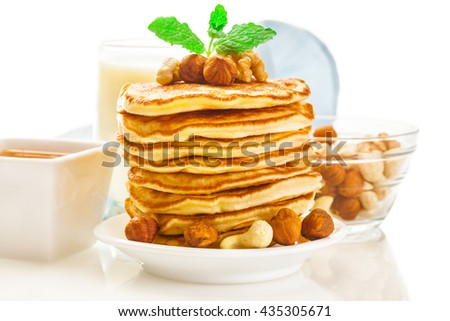 Photo of tasty pancakes with nuts - stock photo