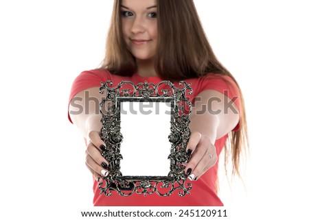 Photo of teenage girl showing photo frame on white background - stock photo