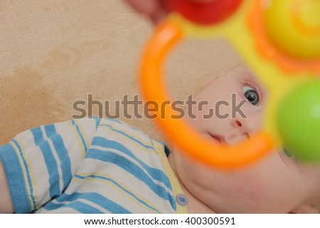 Photo of the Beautiful baby boy, four months old playing
