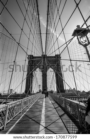 Photo of the Brooklyn Bridge in New York done in black and white.