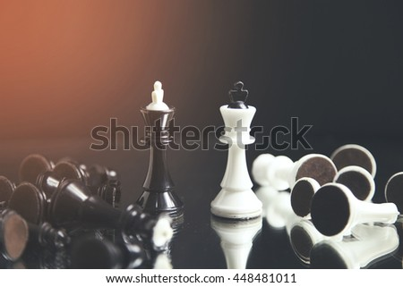 Photo of the chessboard with white and black pawns