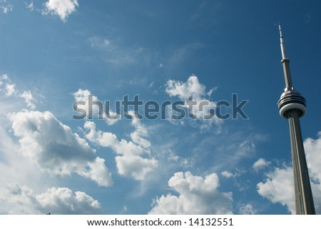 Photo of the CN Tower in Toronto against a blue sky - stock photo