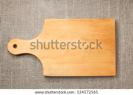 Photo of the cutting board on sacking background - stock photo