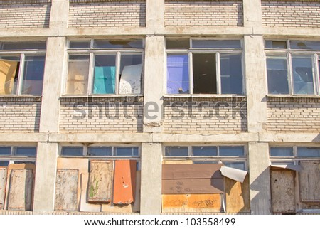 photo of the destroyed and old school - stock photo